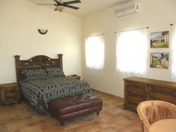 guest bedroom with queen bed, private bath and large view balcony