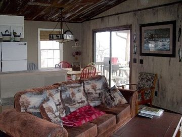 BarnWood Walls are Rustic & 2 sets of Sliding Glass Doors Give Views Galore