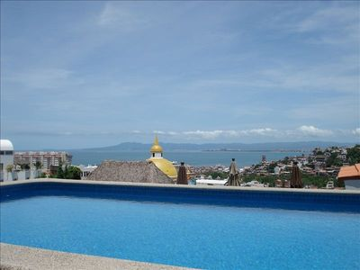 Amaizing view from the sun deck with pool in front of you condo/house
