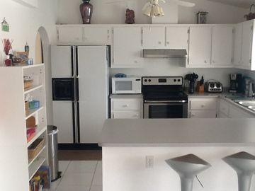 Modern spacious kitchen with huge fridge freezer and ice maker