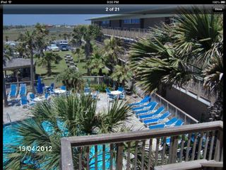North Padre Island condo photo - Pool area with picnic tables and grills .