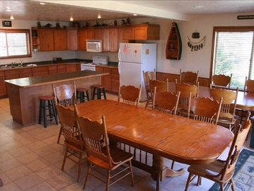 Large Kitchen and 2 tables that seat 16 plus more room at the bar