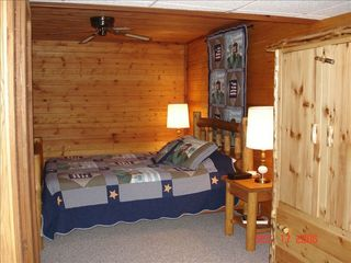 Wisconsin Dells cabin photo - lower level bedroom with cedar lined walls