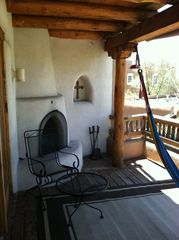 Santa Fe house photo - Portal with fireplace off living room