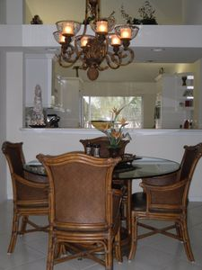 This is the dining area showing upscale table and tropical chandalier.