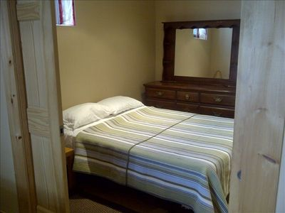 Lower level bedroom with Queen size bed and Pocket doors for privacy