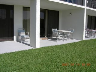 View of Patio from Beach - Crossover Close! - Cocoa Beach condo vacation rental photo
