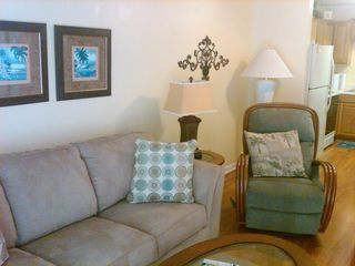 Gulf Shores condo photo - Living Room with new paint, flooring, sofa, chairs and tables!