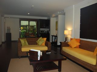 Nusa Dua apartment photo - Living room with rattan sofas