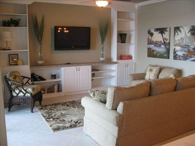 Relax in the comfortable family room overlooking the pond and fountain.