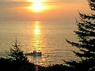 Pemaquid Point cottage photo - Watch Lobstermen hauling traps in early morning light
