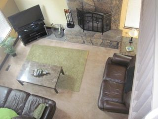 Bend house photo - Plasma TV, Lava rock fireplace, leather couches!