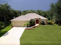 Enjoy a Private Florida Villa Surrounded by Golf Courses and Beaches