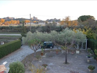 View from master bedroom of olive grove with Alpilles mountains in background