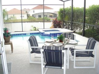 Calabay Parc villa photo - Relax and enjoy dining by the pool
