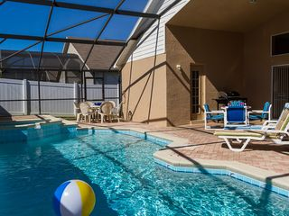 Indian Creek villa photo - Newly resurfaced pool in 2013--sparkling blue w/patio furniture&sunbathe chairs