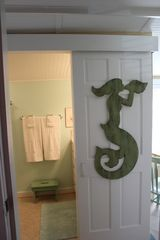 Nags Head cottage photo - Sliding door to bathroom is so cool!