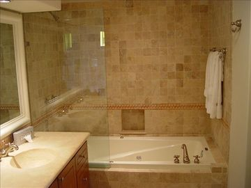 Second master bathroom w/ double sinks, tub and shower