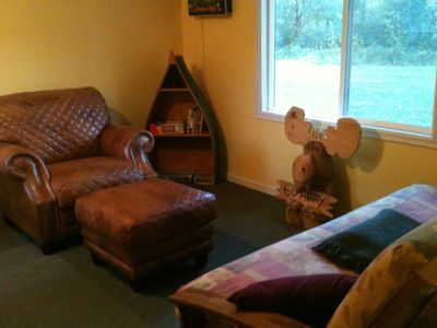 Hastings cabin rental - Relaxing in the three season porch with Futon Bed.