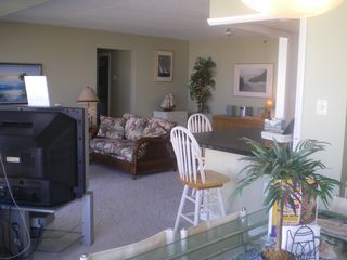 Capri Ocean City condo photo - Full view of Open space dining room, kitchen counter, living room