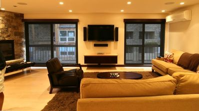 Living Room, 50 inch flat screen suround sound, double doors to deck