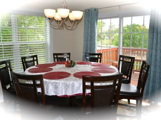 Private Homes house photo - Enjoy meal with family or friends at round table, watch dreamed paradise on deck
