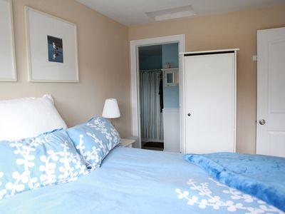 Pacific Beach cottage rental - The queen bed in the master bedroom, with private bathroom.