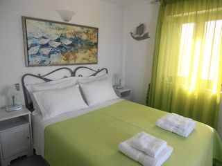 Thira (Fira) villa photo - 2nd floor's bedroom with queen size bed and en-suite bathroom.