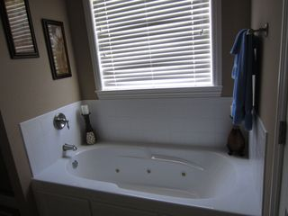 Branson house photo - Jetted tub in master bath, also has walk in shower.