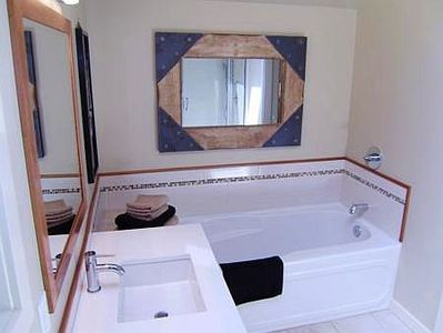 Spacious shower and separate soaker tub.