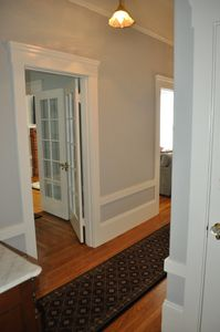 Alternate view of master bedroom and living room doorways from hallway