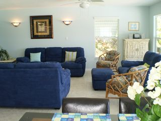 Little Torch Key house photo - Living area adjacent to the dining room, with sconce lights for low lighting.