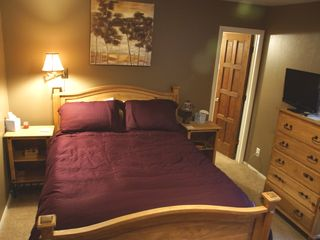 main floor bedroom with queen bed and attached bath - Fraser house vacation rental photo