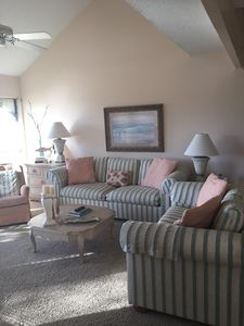 Looking into den from dining area. Queen sleeper sofa & love seat.