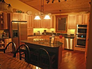 Lutsen lodge photo - A custom kitchen a chef would love! Granite, Jenn-aire and seating for 12.