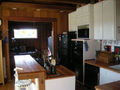 Upstairs gourmet kitchen, double ovens, 5 burner gas  range, informal bar