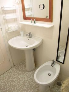 Complete bathroom with, sink, WC, bidet and a powerful shower