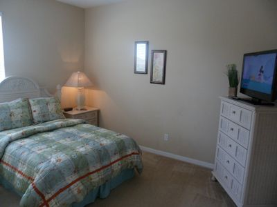 Queen bedroom with LCD HDTV