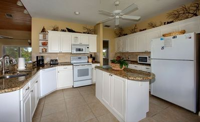 Large Kitchen with granite countertops and it has an eating are off of liv rm 2
