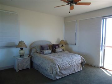 one of the upstairs bedroom, has balcony overlooking the ocean bay.