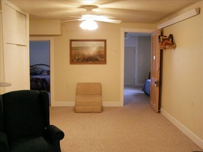 Living room. (Master bedroom at left, 2nd BR on right Linens are provided.)