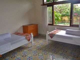 Sanur house photo - 'Kids' bedroom w/ traditional Dutch cement tiles & view to pool & garden.