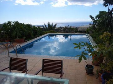 Fantastic swimming pool with sun beds and sea view
