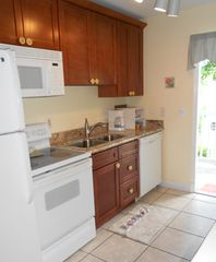 Key West condo photo - Granite counters in kitchen along with dishwasher and icemaker in freezer.