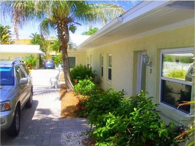 Siesta Key villa rental - Villa #3 Front Door showing Exterior Mirrored Privacy Glass. (Central A/C)