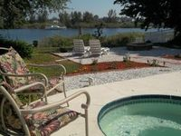 Beautiful waterfront island home with canoe and private heated pool/jacuzzi