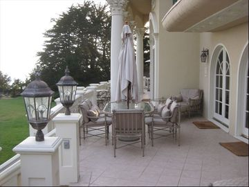 The outer veranda is complete with several comfortable seating areas.
