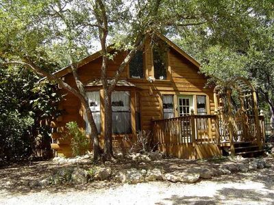 cute log home with fenced backyard for doggie. POOL is ready for you!
