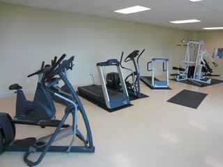Moneta condo photo - Fitness center with cardio equipment, weight machine, and free weights