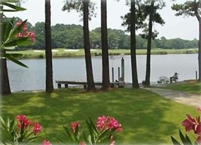 Backyard- Private Dock on 11 Mile Lagoon and Golf  View Beyond